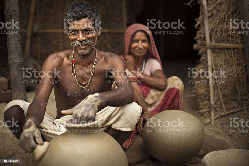 Real people from rural India: Happy potter with his wife. royalty-free stock photo