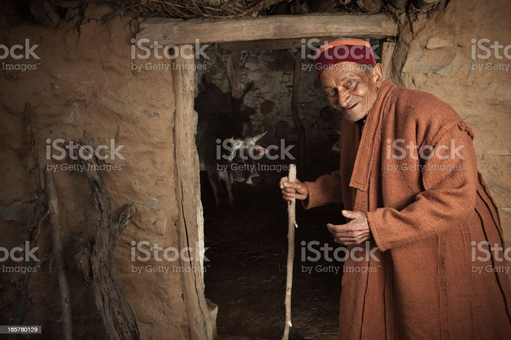 Real people from rural India: Happy Senior man near barn royalty-free stock photo
