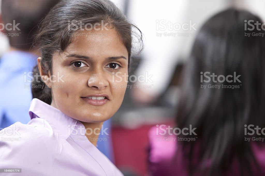 Real People:  Head Shoulders Indian Young Adult Woman Business Meeting royalty-free stock photo