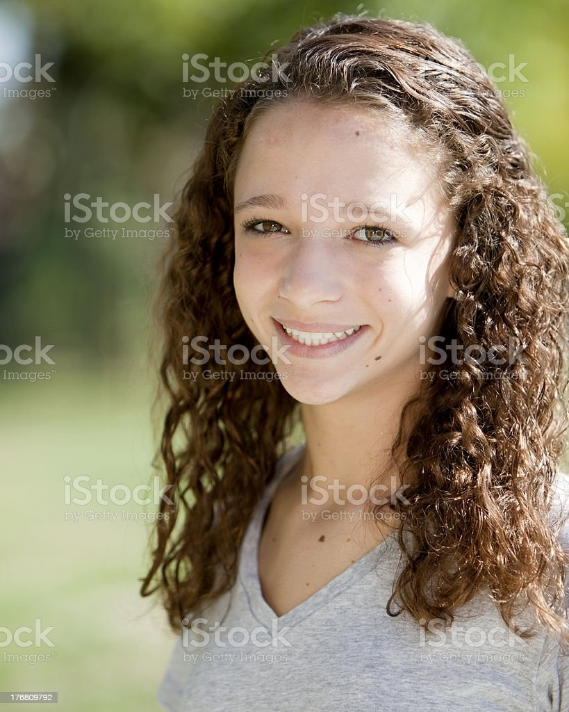 Real People: Head Shoulders Smiling Caucasian Teenage Girl Curly Hair royalty-free stock photo