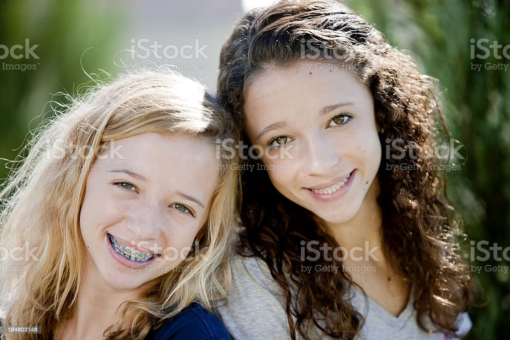 Real People: Head Shoulders Smiling Caucasian Teenage Girls Sisters Twins stock photo