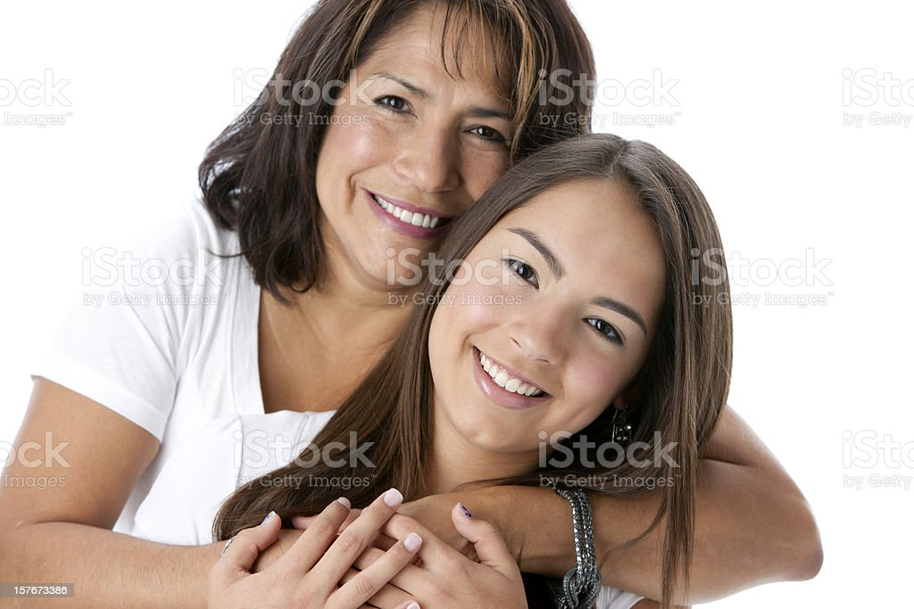 Real People: Head Shoulders Smiling Hispanic Mother and Teenage Daughter royalty-free stock photo