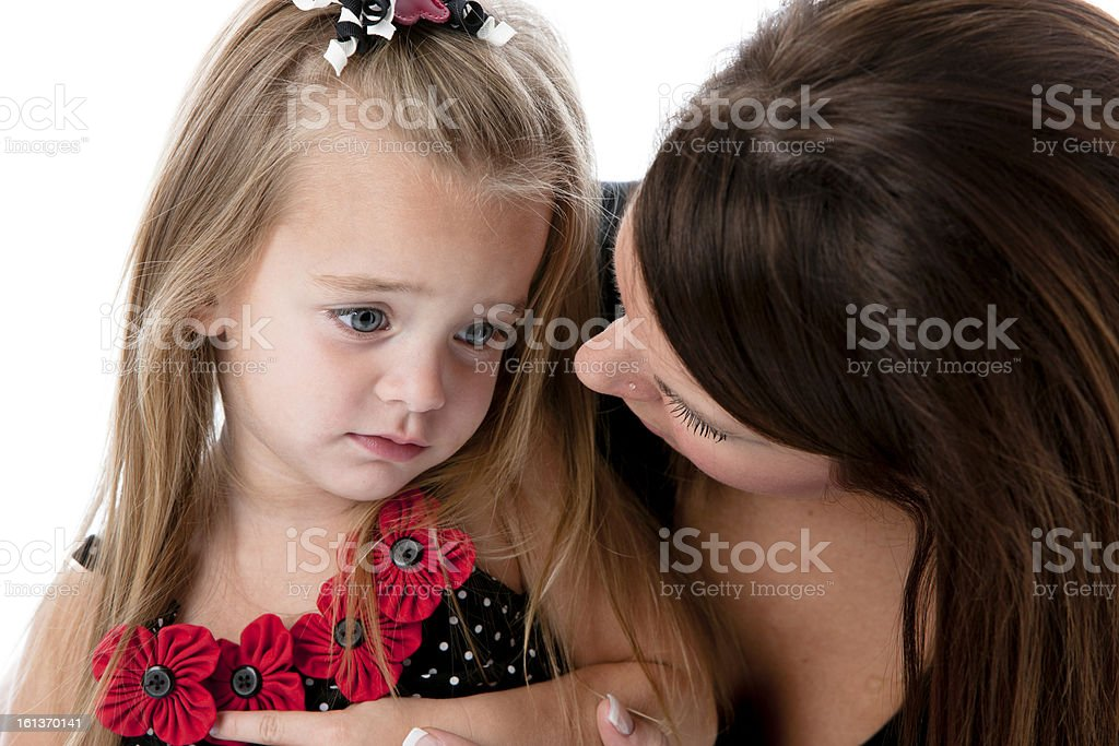 Real People: Headshot Caucasian Young Adult Mother Comforting Her Daughter stock photo