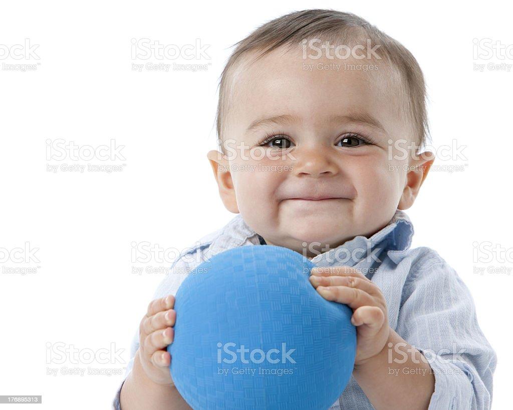 Real People: Headshot Smiling Caucasian Toddler Boy Holding Ball royalty-free stock photo