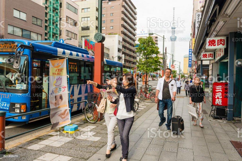 Real People in Asakusa Tokyo Urban City Sidewalk Scene stock photo