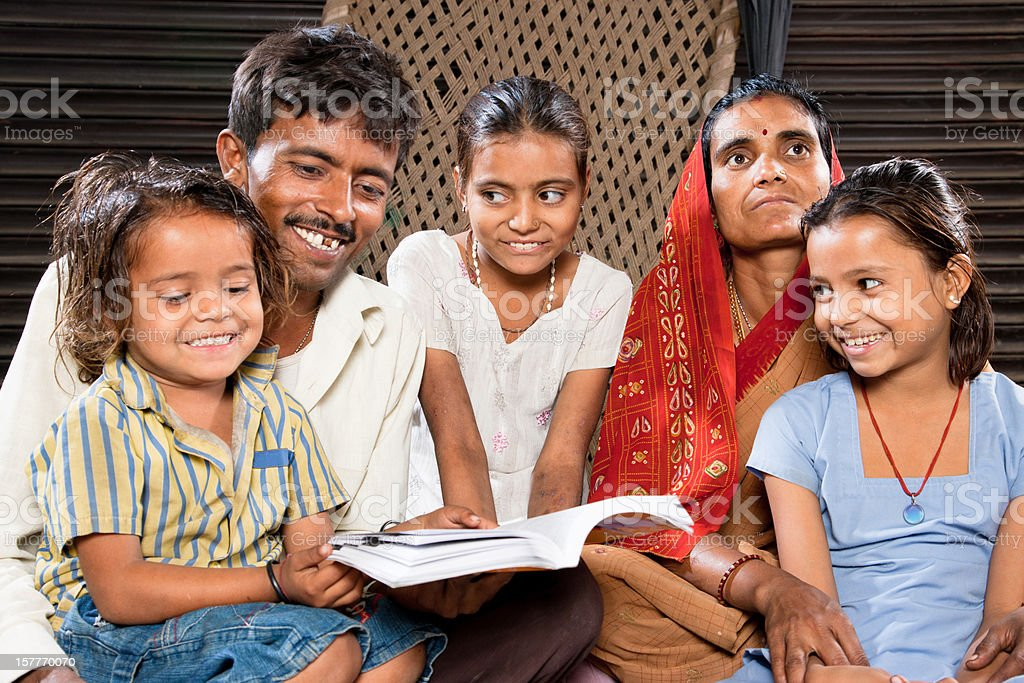 Real People Indian Family Sitting Together Reading A Book royalty-free stock photo