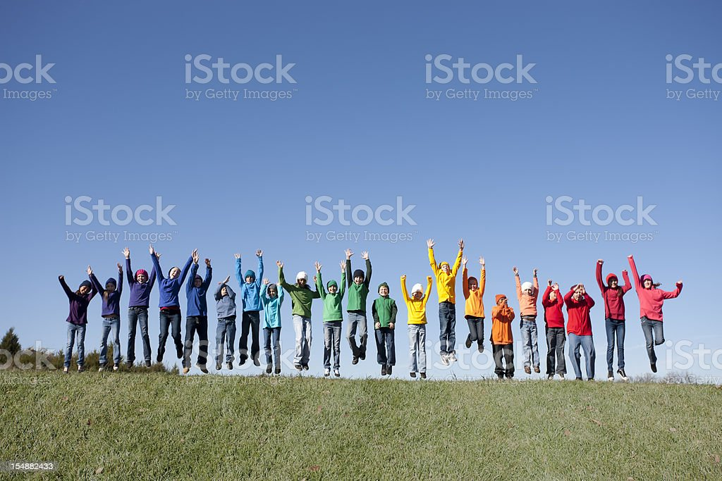 Real People: Large Group Multi-Racial Children Jumping Together Outdoors Diversity royalty-free stock photo