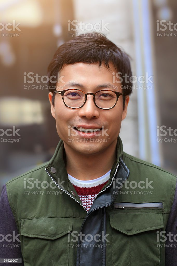Asian man on the street with ample copyspace.
