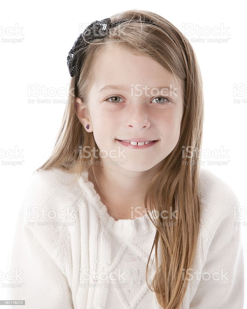 Real People: Smiling Caucasian Little Girl Bow Pierced Ears stock photo
