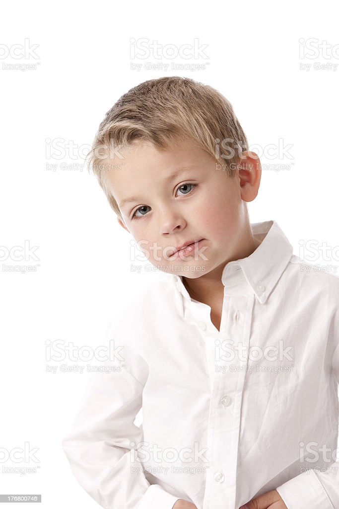 Real People: Waist Up Caucasian Little Boy Looking Pensive stock photo