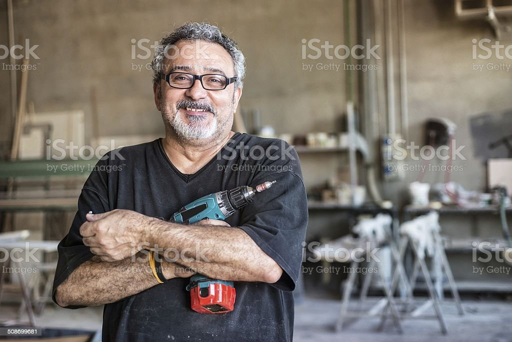Real people - Worker with Drill stock photo