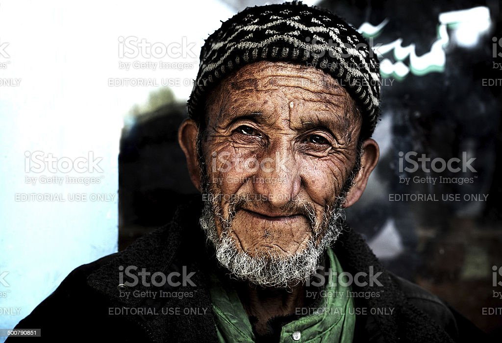 Real Portrait of old indian smiling man stock photo
