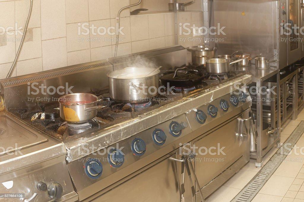 Real restaurant kitchen, filtered, haze effect stock photo
