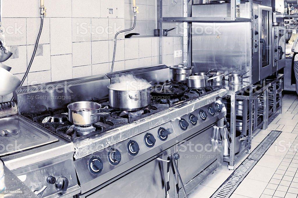 Real restaurant kitchen, toned image stock photo