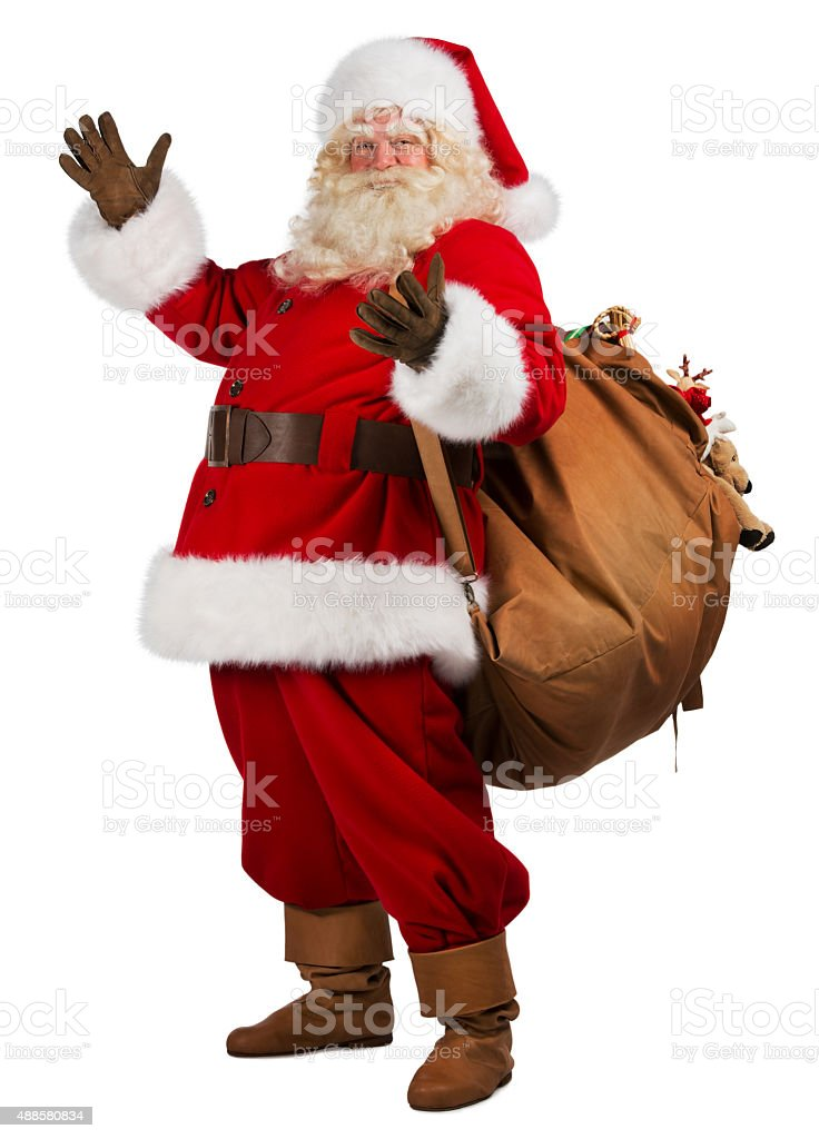 Real Santa Claus carrying big bag full of gifts, isolated stock photo