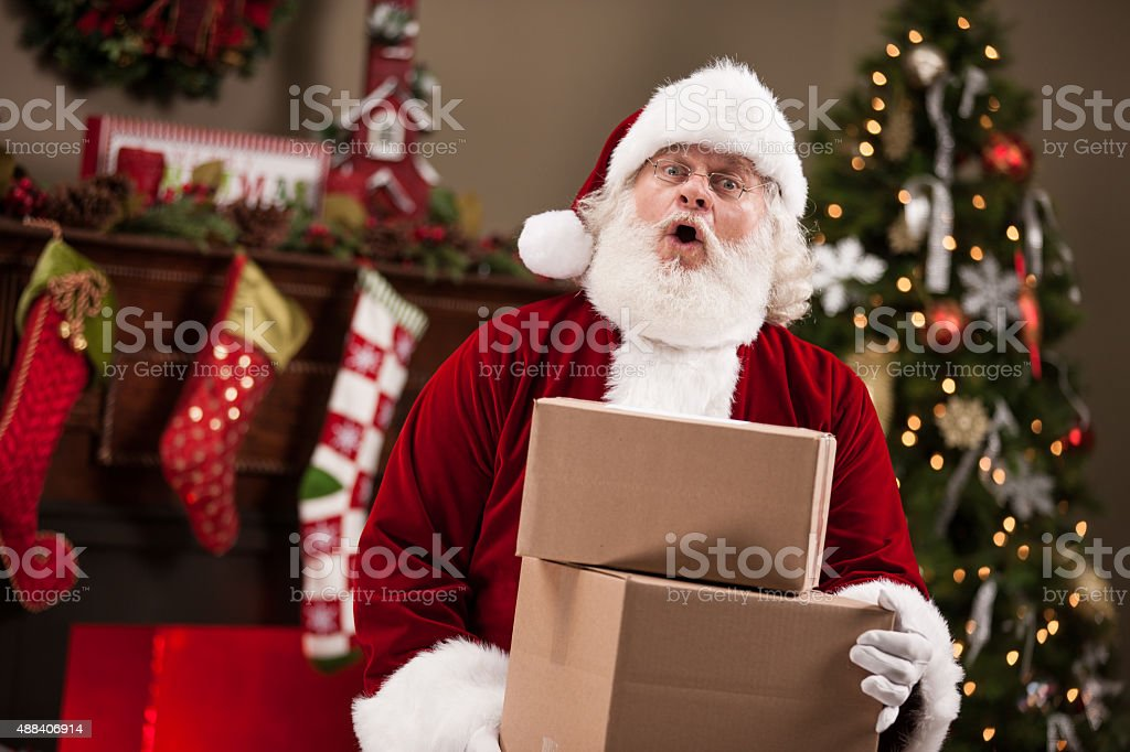 Real Santa Claus With Shipping Boxes stock photo
