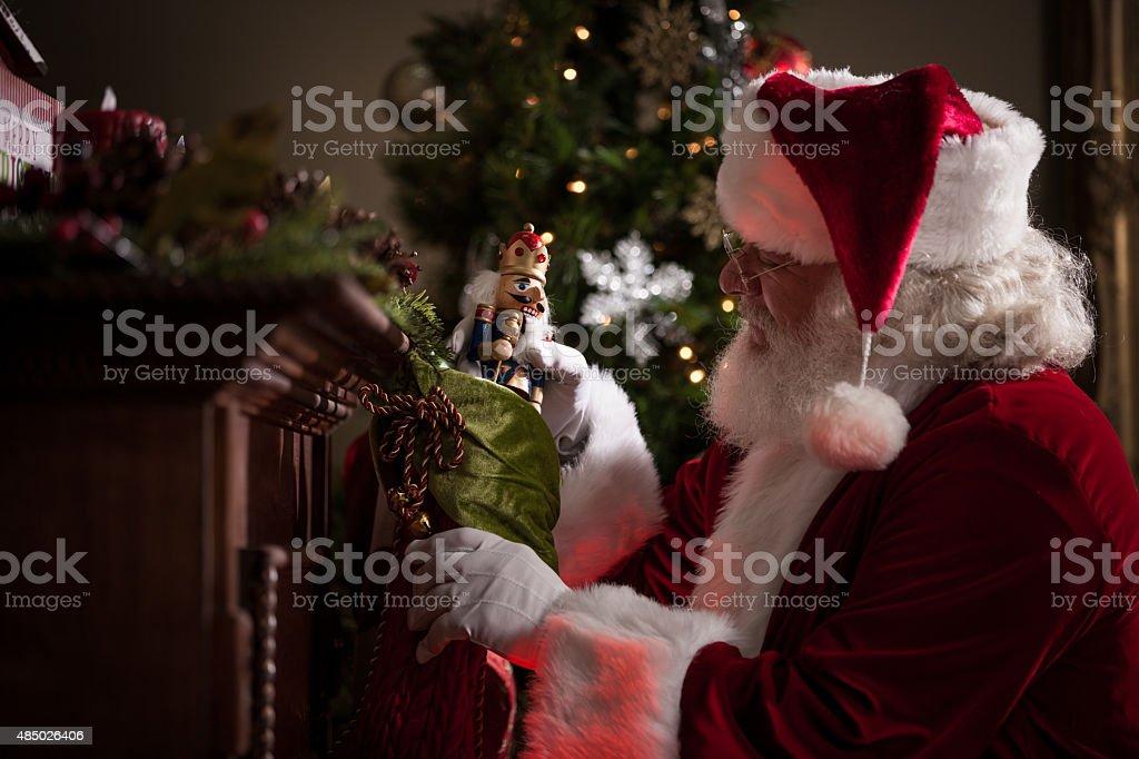 Real Santa Stuffing Stockings stock photo