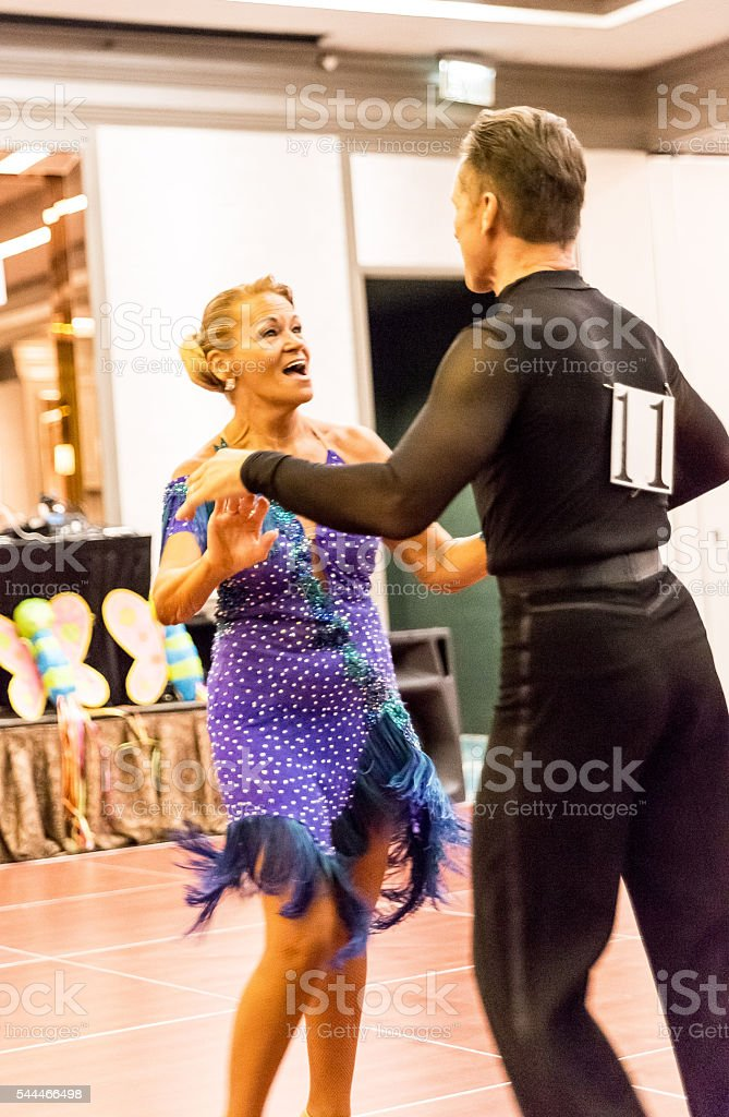 Real senior ballroom dancers at dance competition stock photo