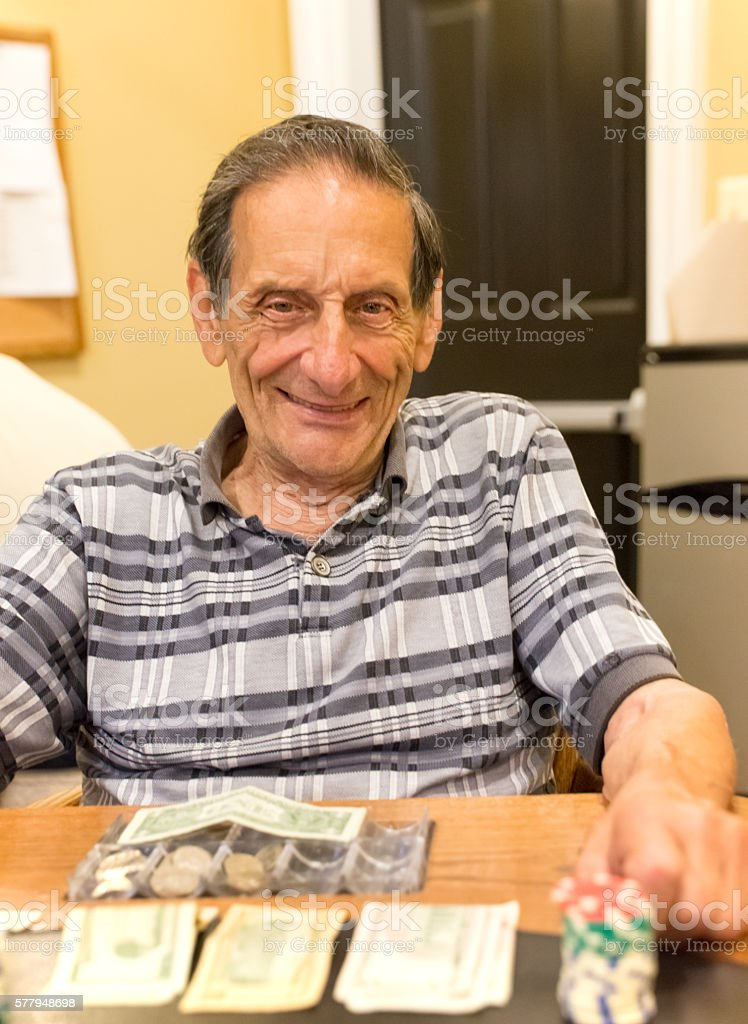 Real Situation-Portrait of caucasian male senior poker player stock photo
