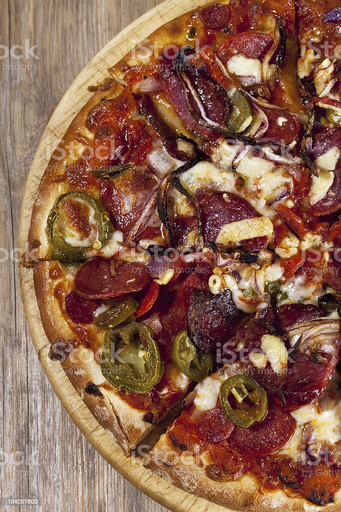 real sliced pepperoni pizza on wood royalty-free stock photo