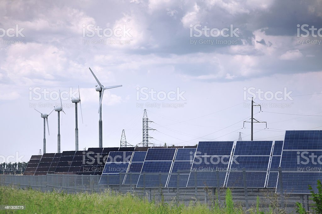 real solar panels and windmill stock photo