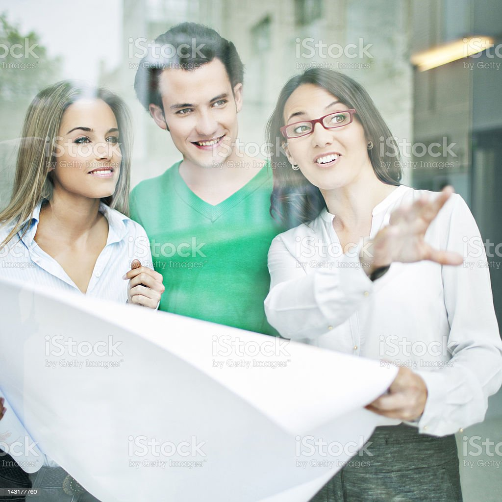 Real state agent showing a couple a property.