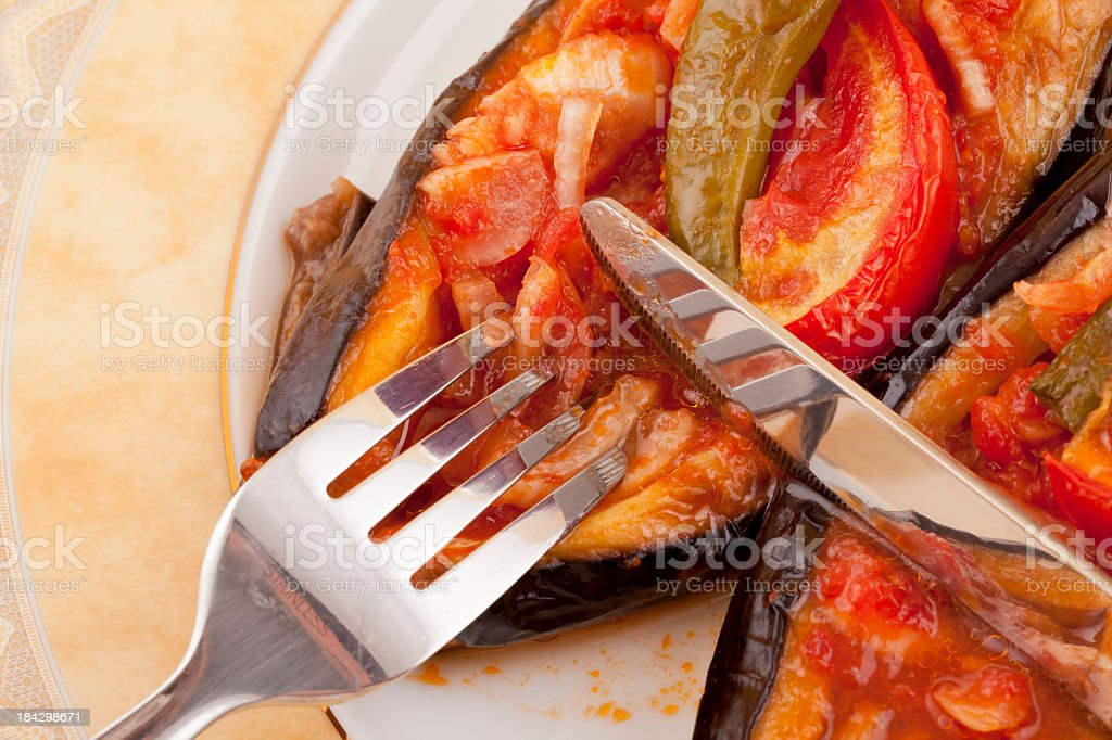 real stufted eggplant: fork and table knife stock photo