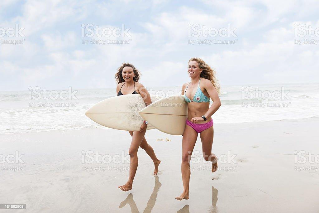 Real Surfer Girls Running royalty-free stock photo