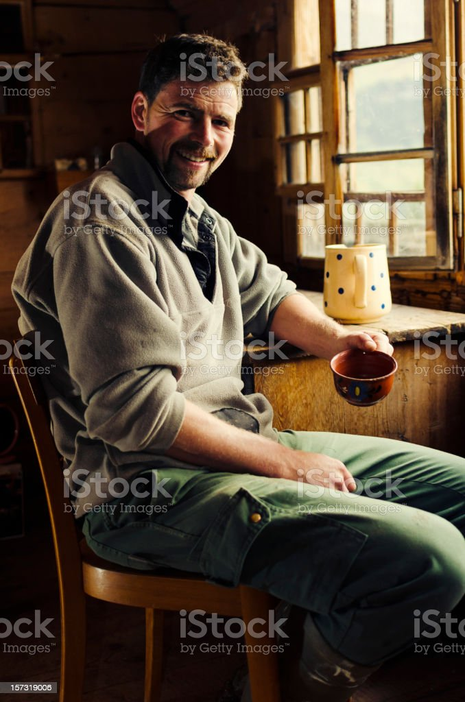 Real Swiss Alpine farmer smiling to the camera stock photo