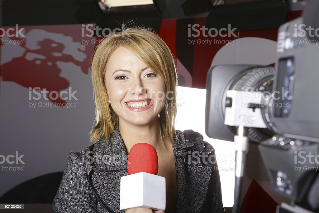 Real television news reporter and video camera stock photo