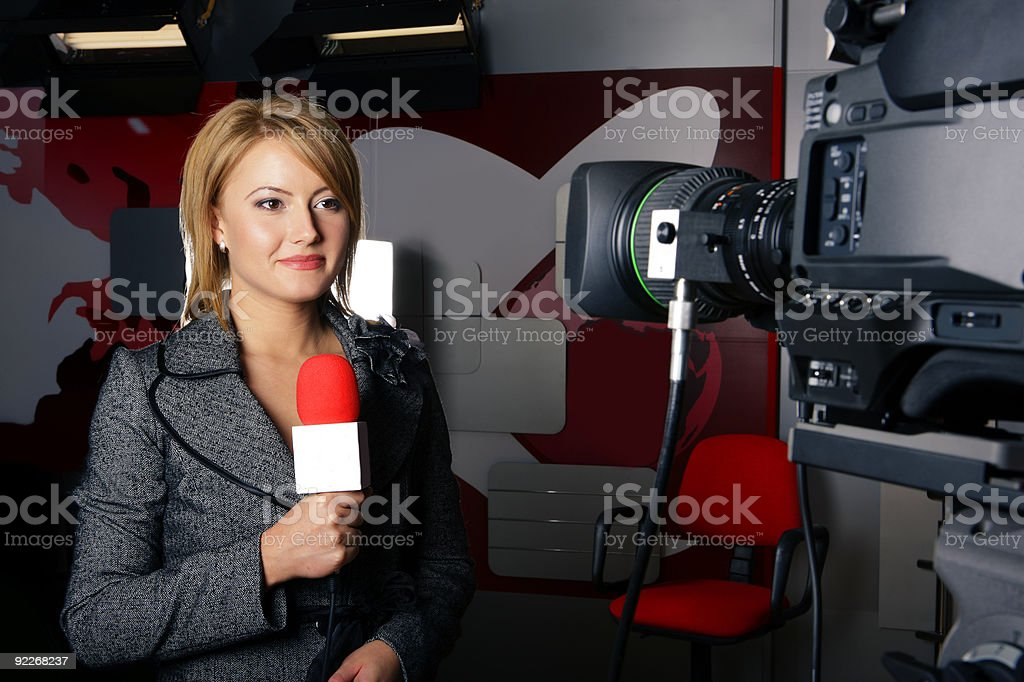 Real tv news reporter in front of the video camera stock photo