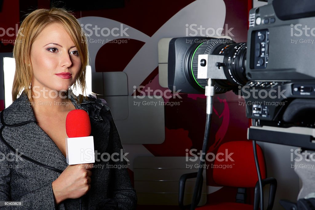 Real TV reporter with breaking news royalty-free stock photo