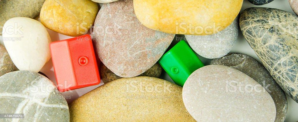 real value hidden under pebble stones stock photo