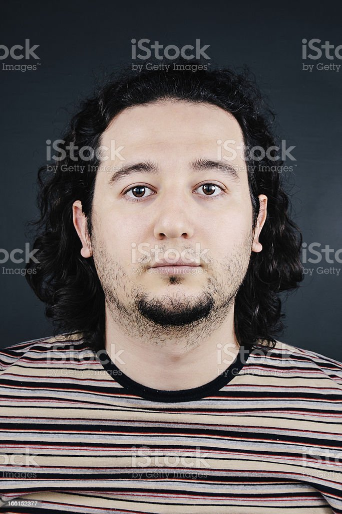 Real young curly hair man portrait royalty-free stock photo