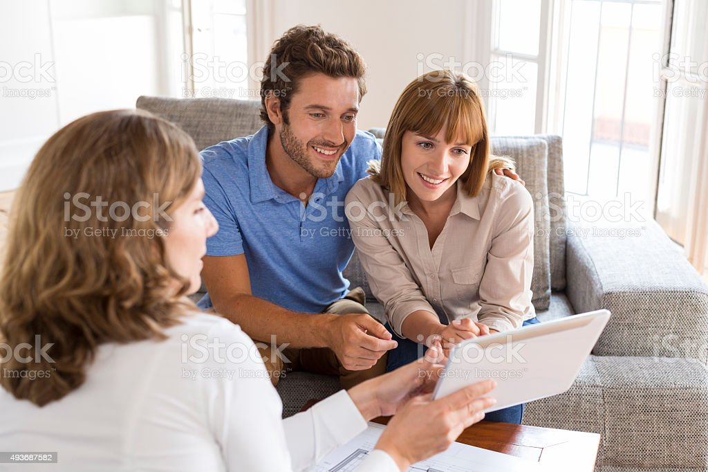 Real-estate agent presenting a new project property on digital t stock photo