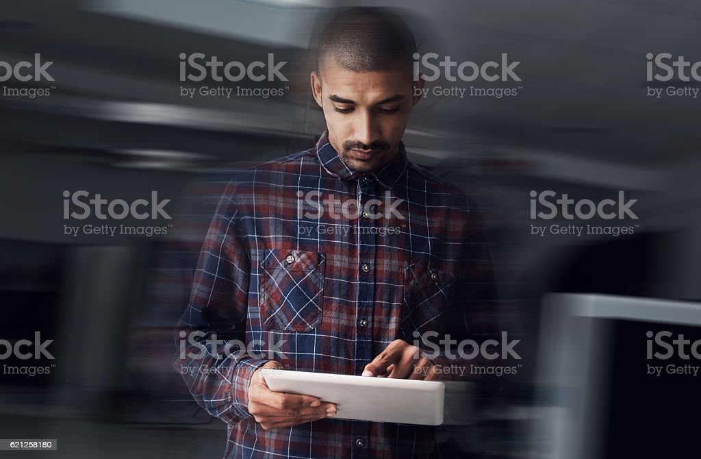 Realising his true business success through the platform of technology stock photo