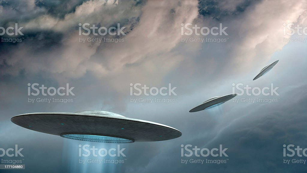 Realistic drawings of flying saucers or UFO's in the sky stock photo