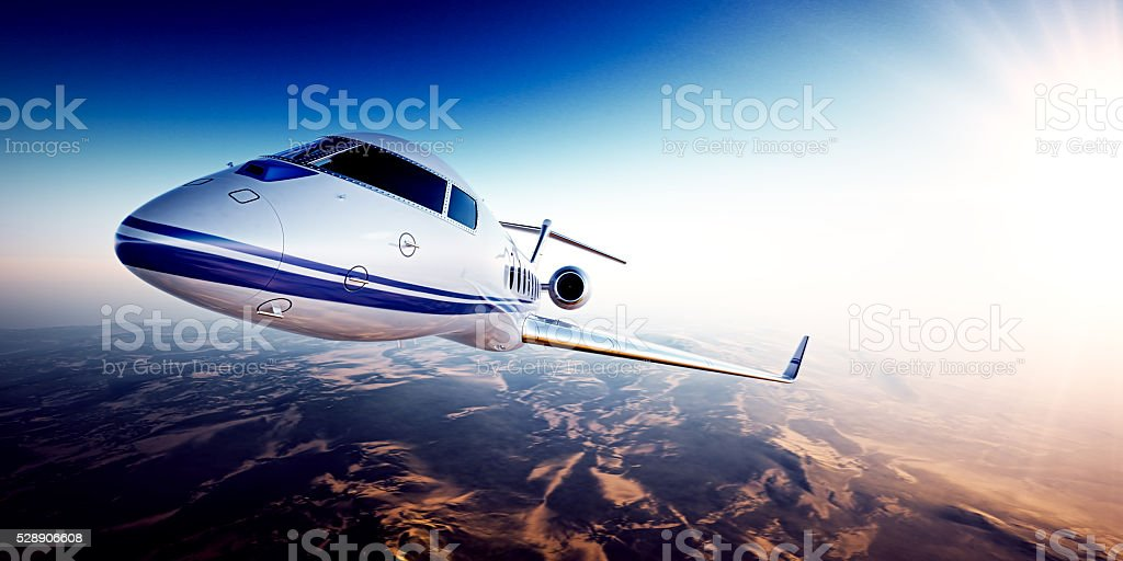 Realistic image of White generic design private jet flying over stock photo