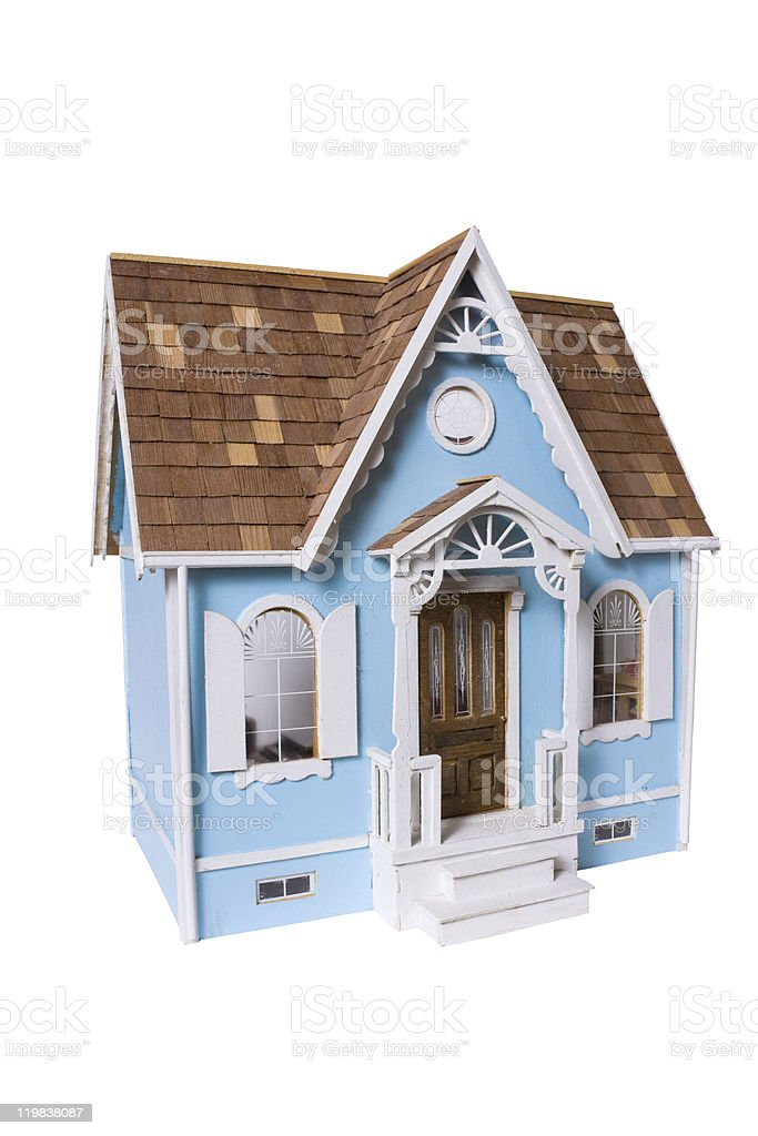 Realistic wooden blue and white dollhouse with brown roof stock photo