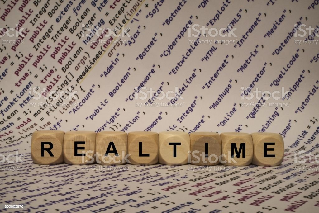 realtime - cube with letters and words from the computer, software, internet categories, wooden cubes stock photo