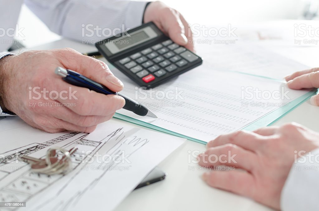 Realtor advising his client stock photo