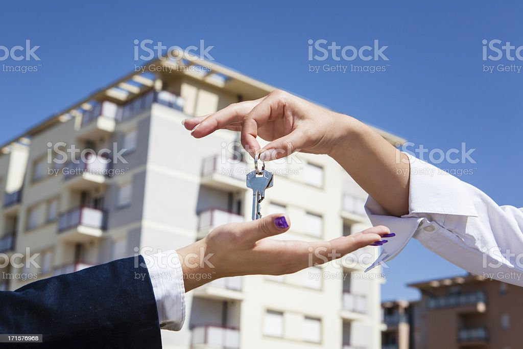 Realtor giving apartment keys stock photo