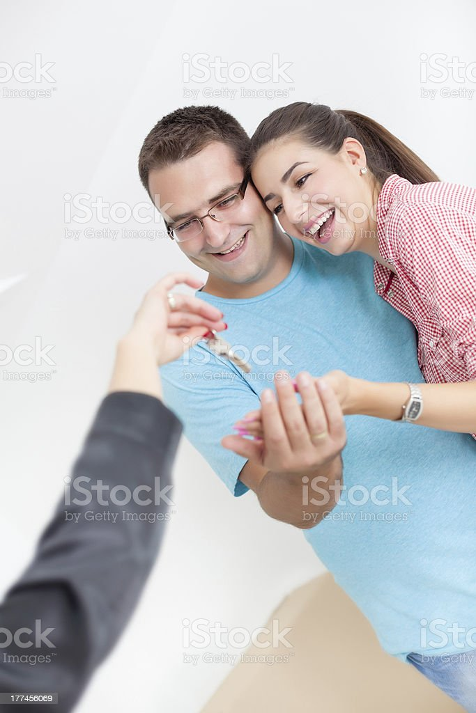 Realtor giving apartment keys royalty-free stock photo