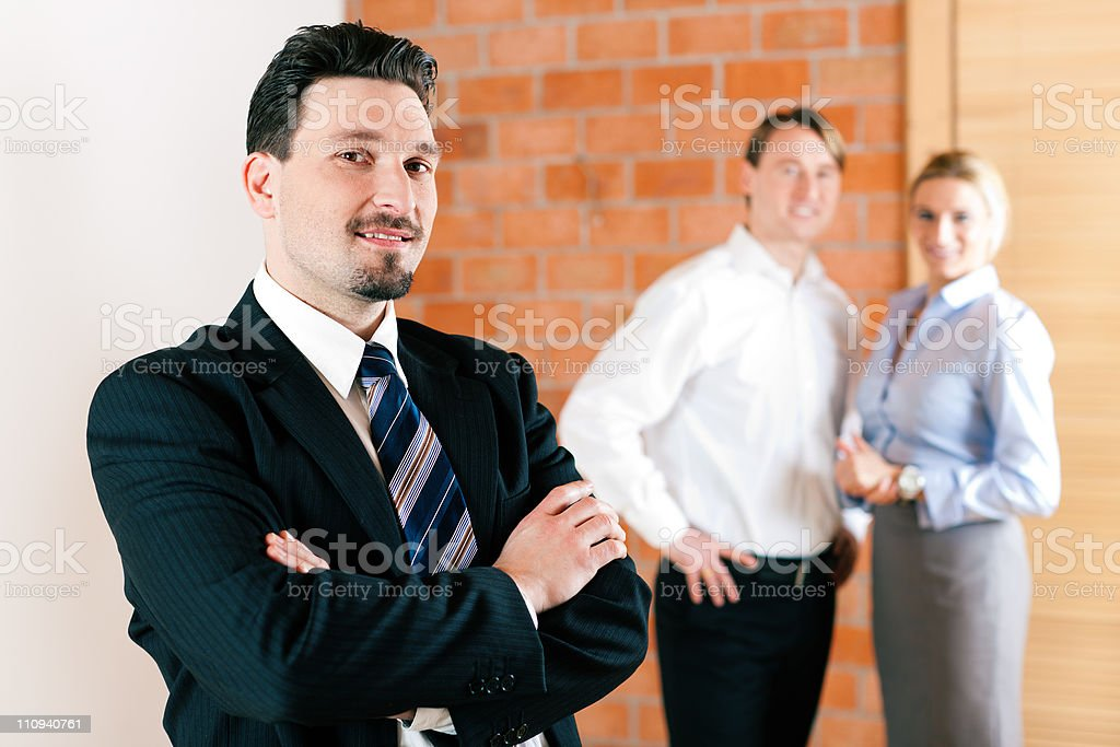 Realtor in apartment with couple royalty-free stock photo