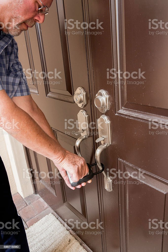 Realtor opening lock box to get key to the house. stock photo