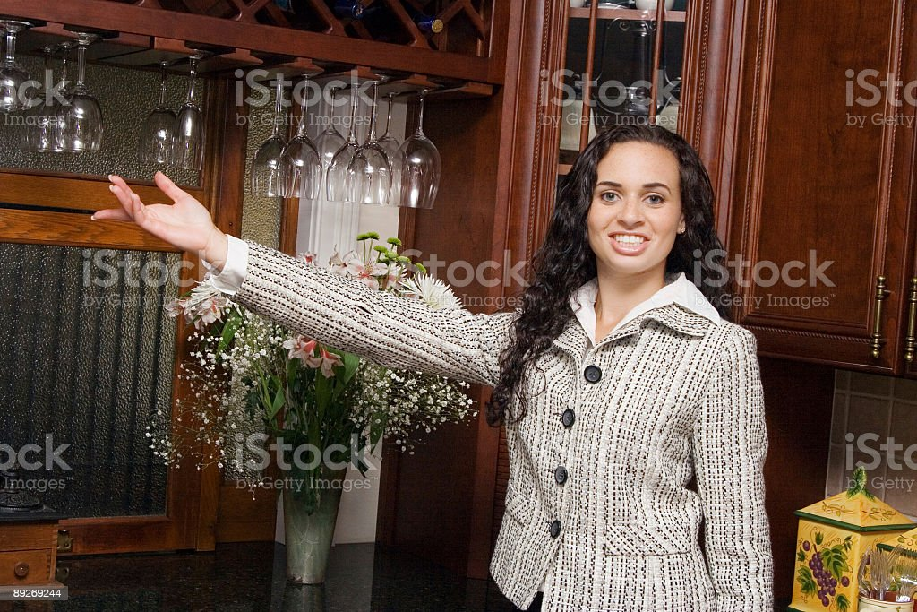 Realtor showing off the kitchen royalty-free stock photo