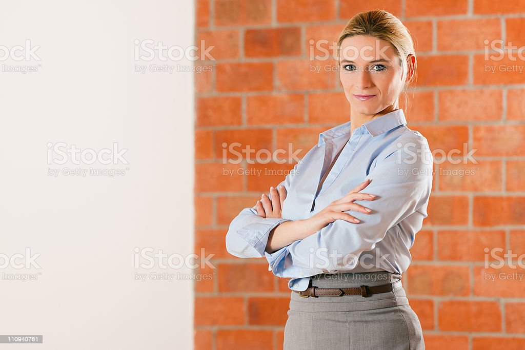Realtor standing in empty apartment royalty-free stock photo
