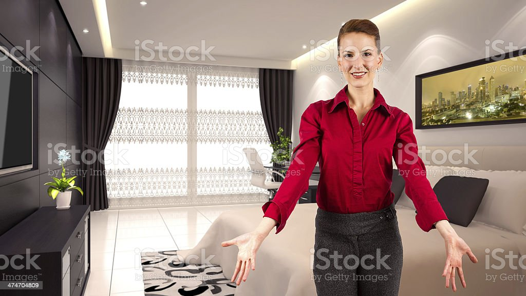 Realtor With Arms Out in Welcome Home Gesture stock photo