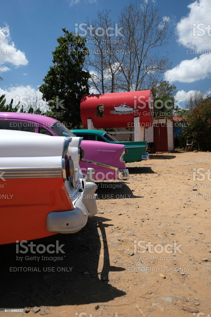 Rear bumper view of parked brightly colored classic cars in Cuba stock photo