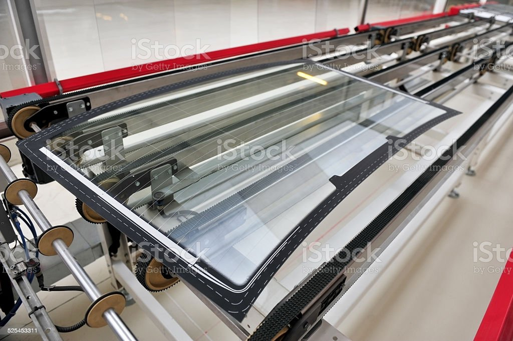 Rear car glass on the factory line stock photo